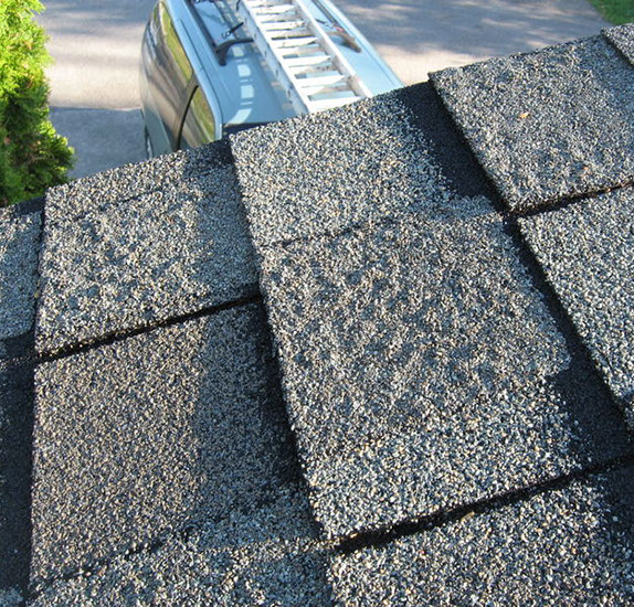 Warning signs of blistering shingles a roof that needs replacement